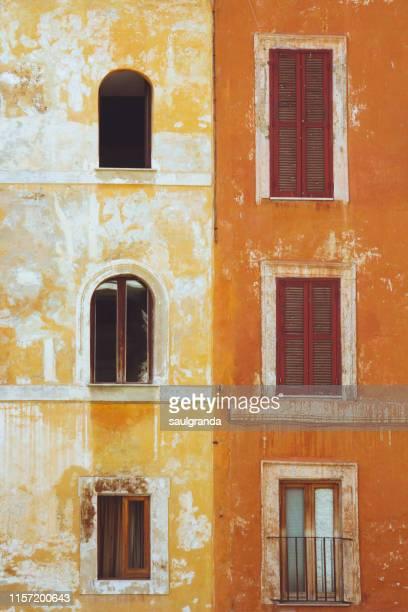 old orange facades - culture méditerranéenne photos et images de collection