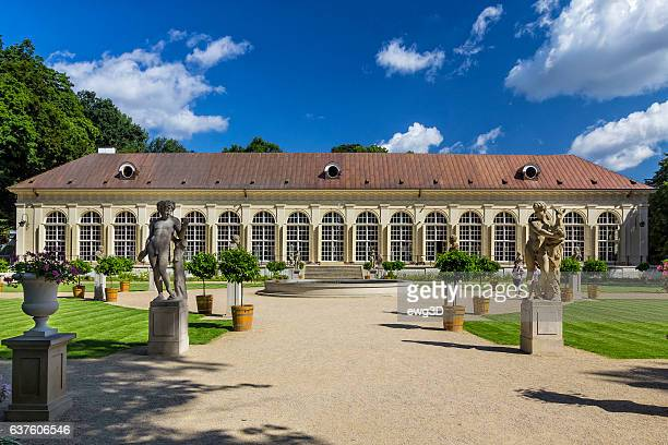 old orangery in warsaw's royal baths park, poland - orange grove stock photos and pictures