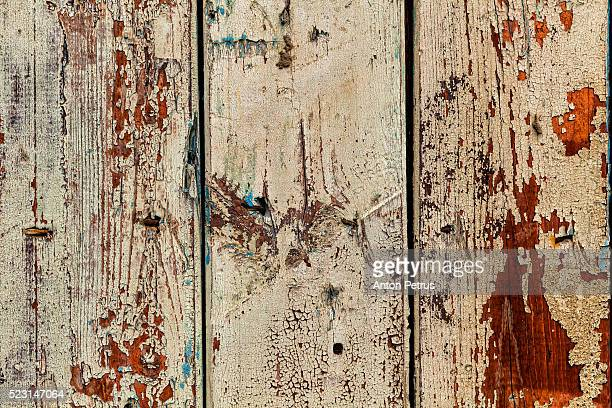 Old paint on a wooden wall