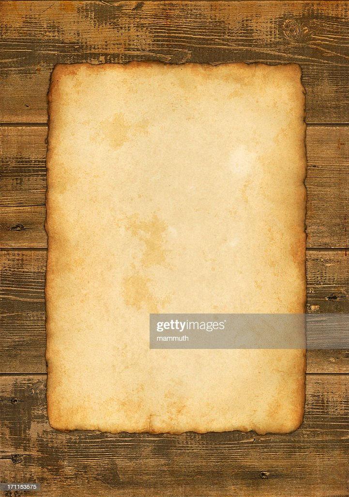 old paper on wooden background : Stock Photo