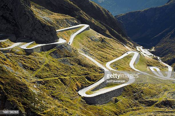 old pass street uphill to san gottardo - mountain pass stock pictures, royalty-free photos & images