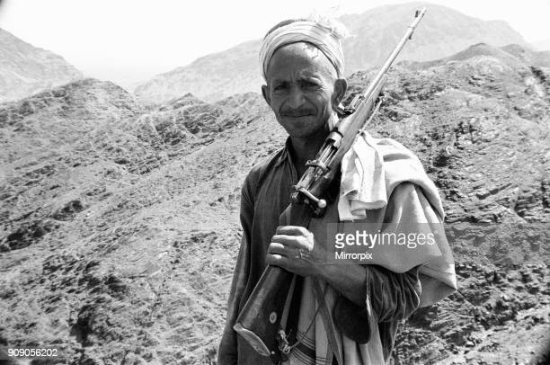 Old Pathan tribesman carries a old bolt action rifle at the Khyber Pass on the border between Pakistan and Afghanistan April 1977