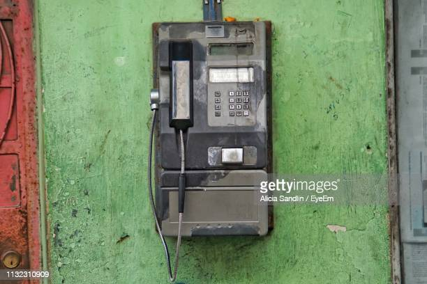 Old Pay Phone Against Wall Outdoors