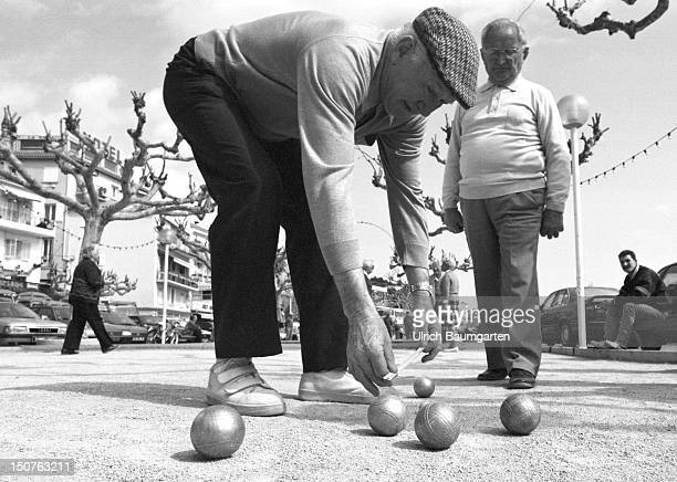 Old people during their ' national sport ' the Petanque play Scene at the little village Le Lavandou on the Cote d'Azur