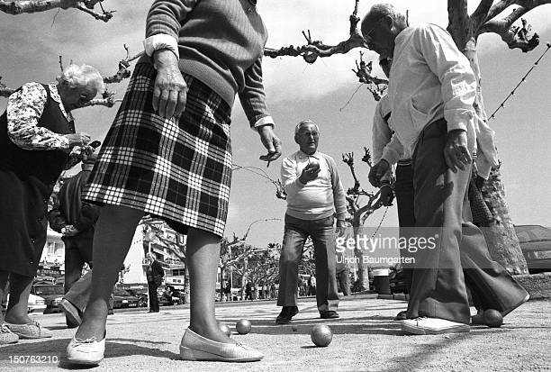 Old people during their ' national sport ' the Petanque play Scene in the little village Le Lavandou on the Cote d'Azur