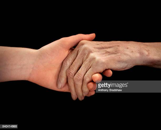 Old person holding hands
