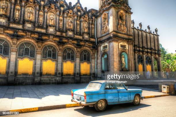 Old Peugeot 404 in front of the Holy Trinity Cathedral in Addis Ababa, Ethiopia