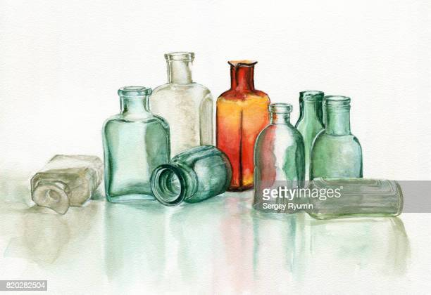 old pharmacy's glassware - potion stock photos and pictures