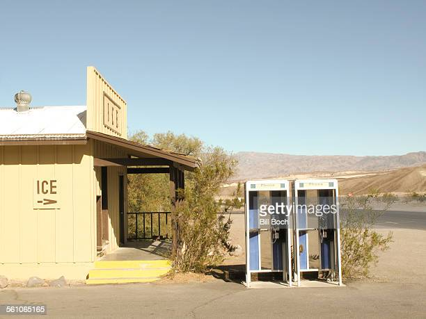 Old phone booths on a hot desert road