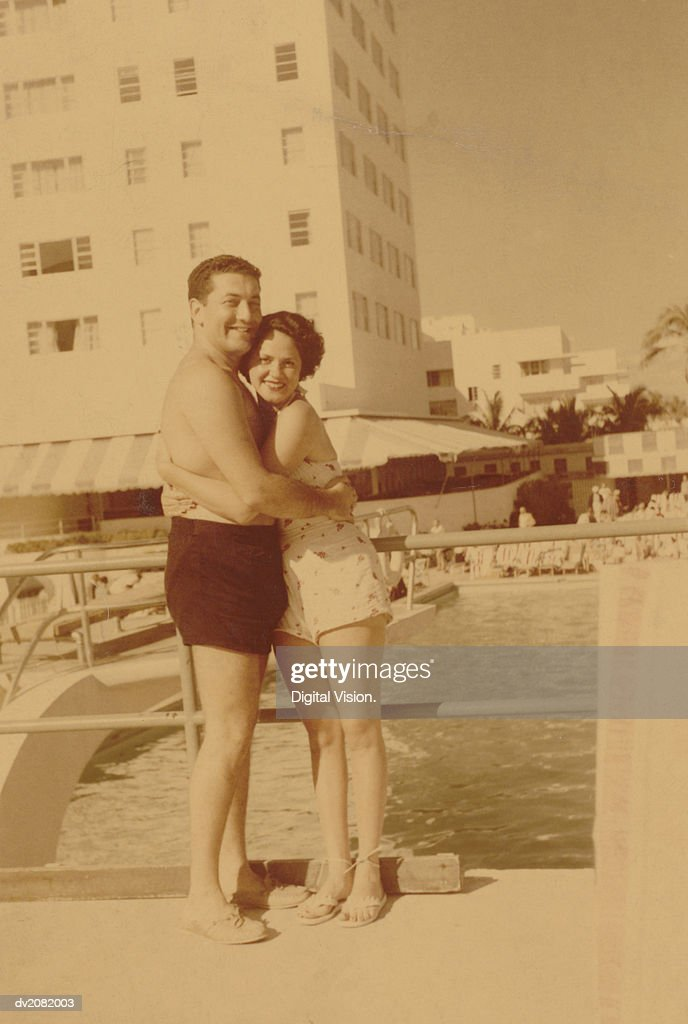 Old Photograph of a Couple Embracing by a Swimming Pool : Stock Photo