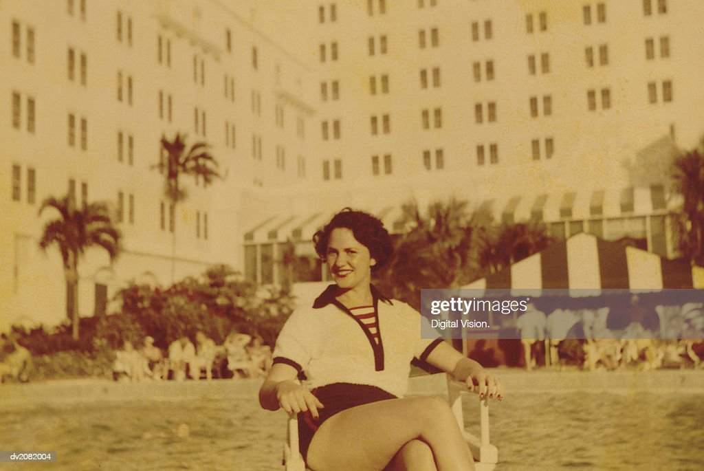 Old Photograph of a Woman Sitting Outside a Hotel : Stock Photo
