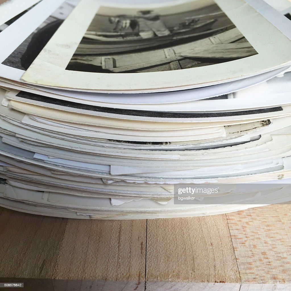 Old Photographs in a Stack on WOod : Stock Photo