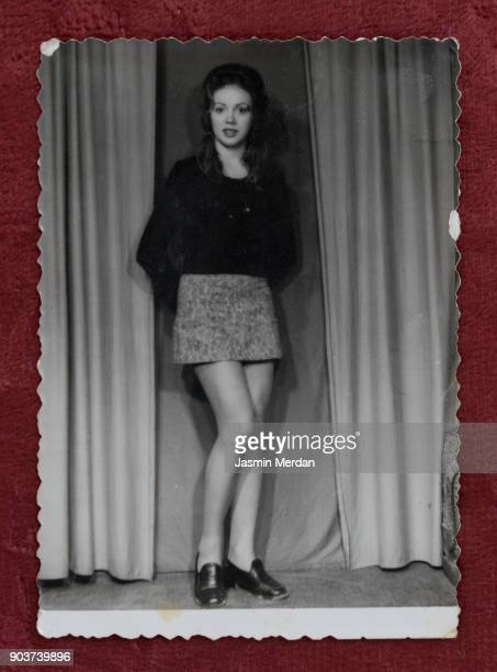 Old photos of young woman in photography studio posing