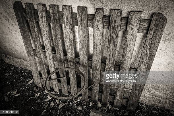 old picket fence leaning against wall - andres ruffo stock pictures, royalty-free photos & images