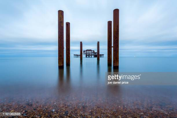 old pier, brighton, east sussex, england - brighton stock pictures, royalty-free photos & images