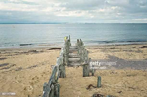 Old pier on beach