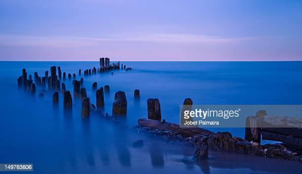 old pier remains - evanston illinois stock photos and pictures