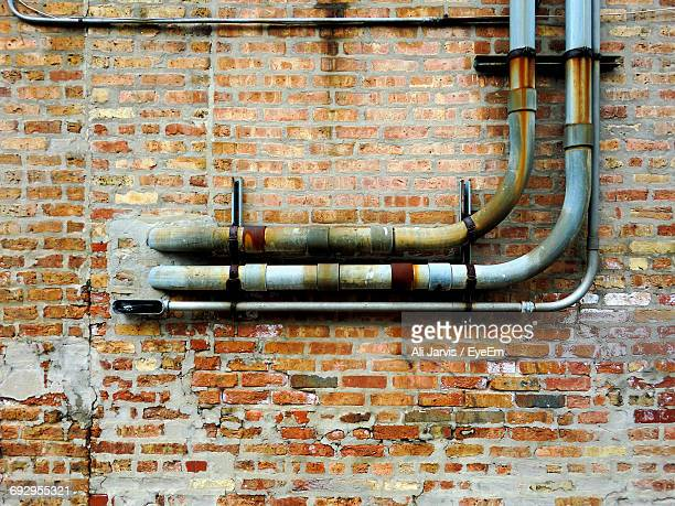 Old Pipes On Brick Wall
