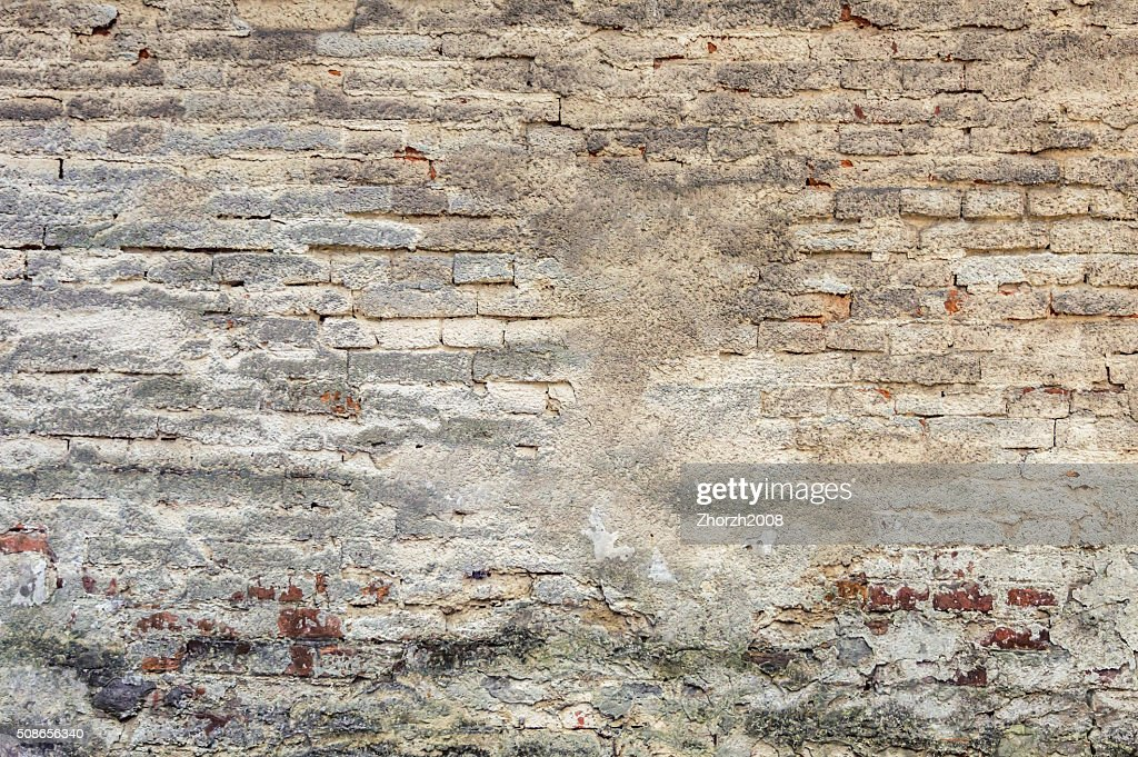 Old plaster on brick wall : Stock Photo