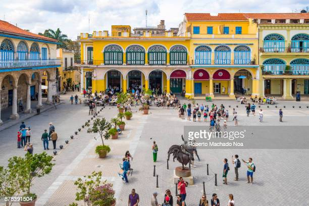 Old Plaza in Old Havana aerial view Old vintage colorful colonial buildings and tourists sightseeing the popular famous place in the Cuban capital...