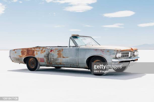 old pontiac convertible parked on salt flats - rusty old car stock pictures, royalty-free photos & images