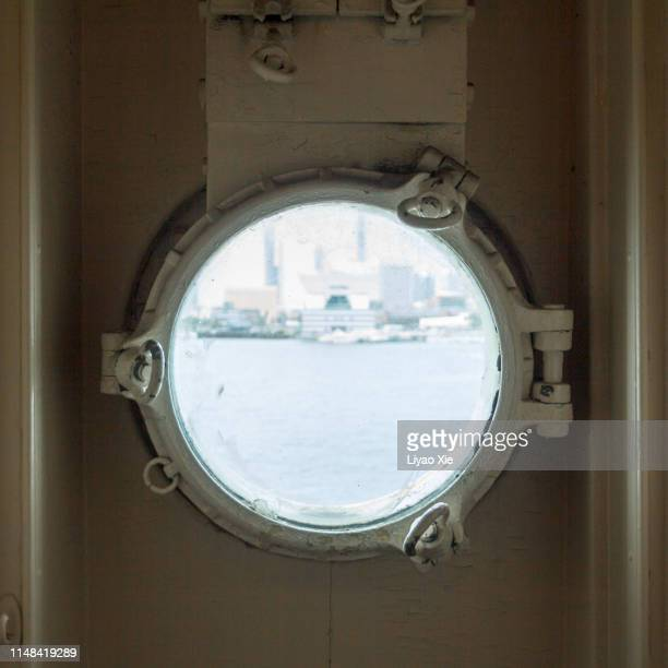 old porthole - ship front view stock photos and pictures