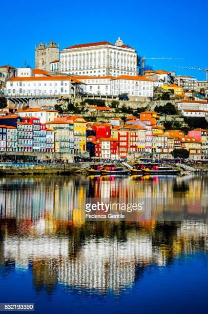old porto reflected in river douro - douro river stock-fotos und bilder