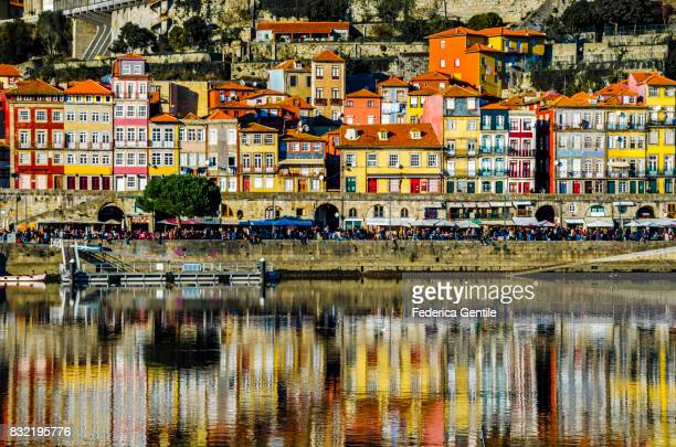 Old Porto reflected in river Douro
