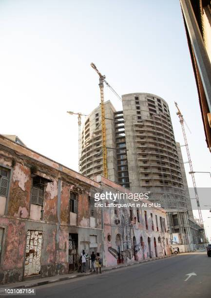 Old portuguese colonial building in front of a new skyscraper Luanda Province Luanda Angola on July 21 2018 in Luanda Angola