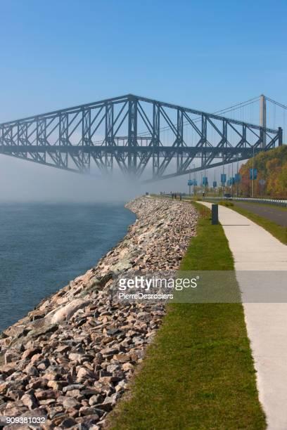 Old Quebec bridge in fog.