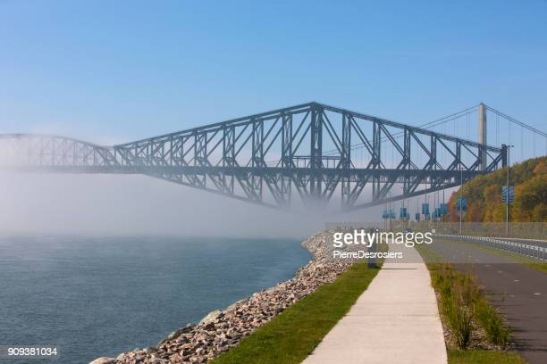 old quebec bridge in fog. - quebec city stock pictures, royalty-free photos & images