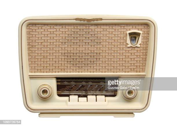 old radio on white background - global radio studios stock photos and pictures