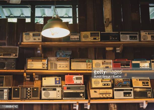 old radios on shelf in illuminated room - eyeem collection stock pictures, royalty-free photos & images