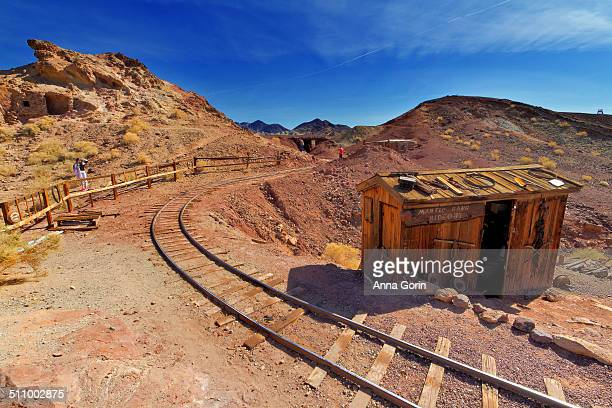 Old railroad tracks leading into mines on mostly clear February morning at Calico Ghost Town. Calico is a popular tourist attraction outside Barstow,...