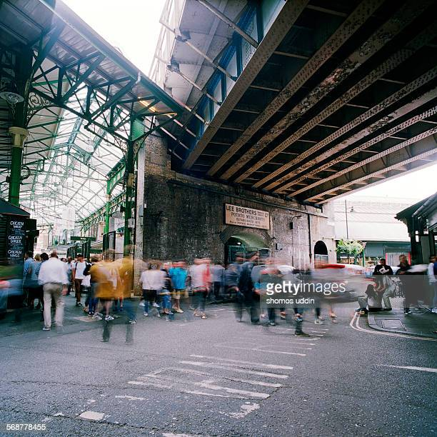 old railway bridge running over borough market - borough market stock pictures, royalty-free photos & images