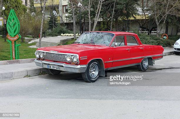 old red american car at ankara turkey - chevrolet impala stock pictures, royalty-free photos & images