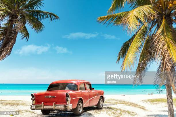 old red american car on varadero beach in cuba - cuba foto e immagini stock