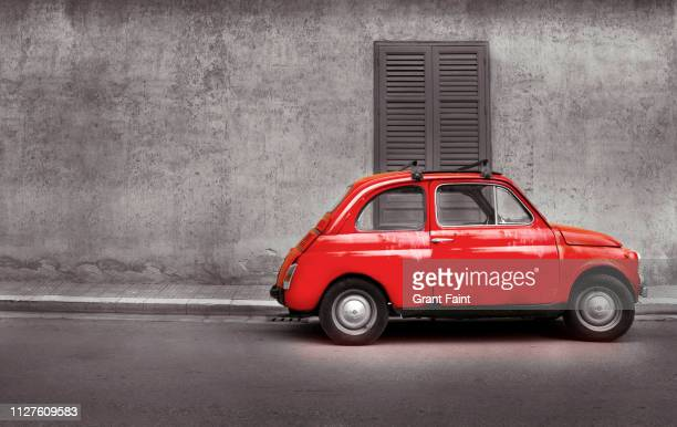 old red car on street. - vintage car stock pictures, royalty-free photos & images