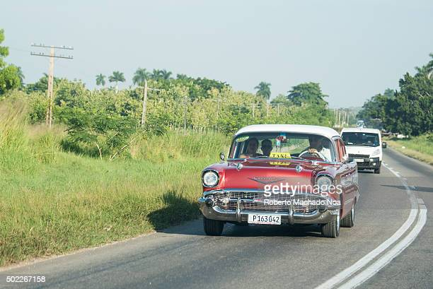 Old red Chevrolet from 1957 working as an intercity taxi seen in the Central road The lack of importing vehicles has forced the Cubans to innovate...