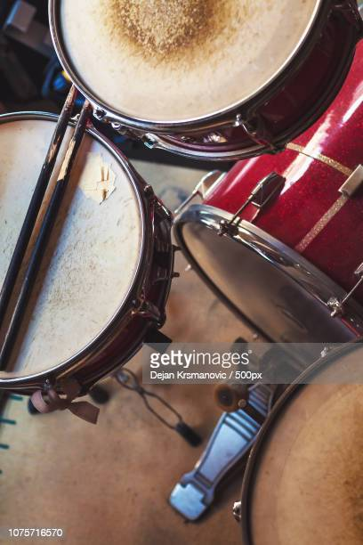 old red drums - modern rock stock pictures, royalty-free photos & images