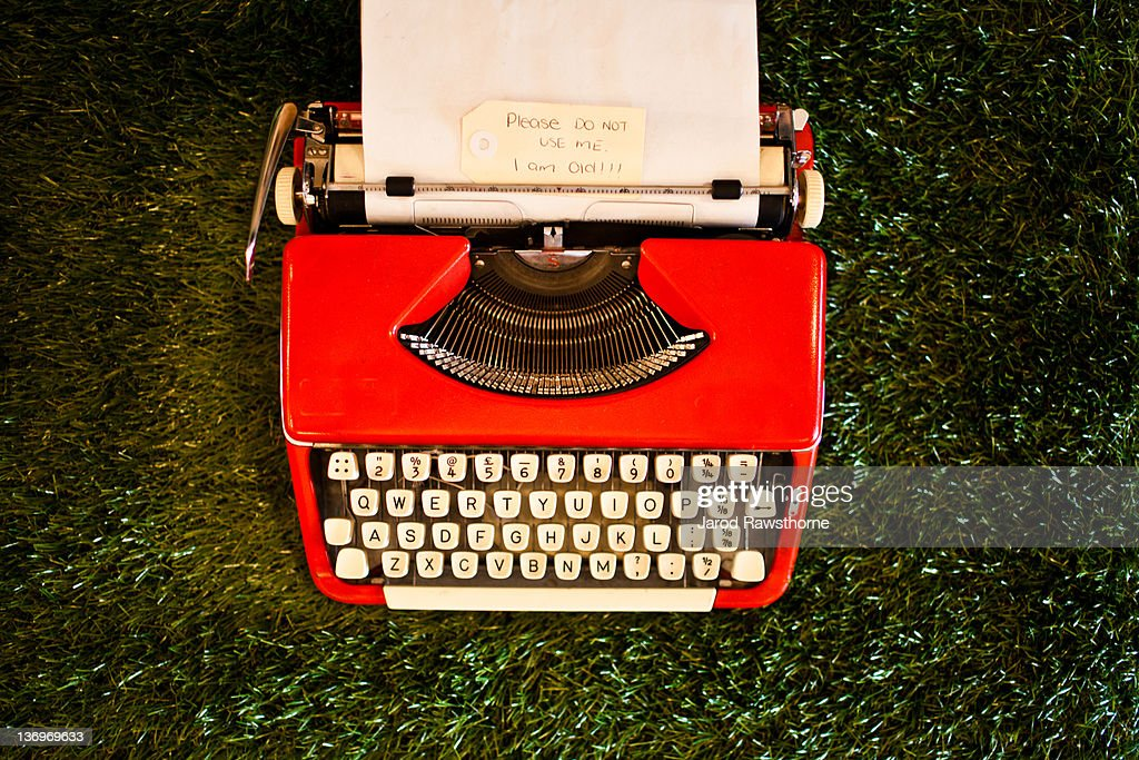 Old red typewriter : Stock Photo