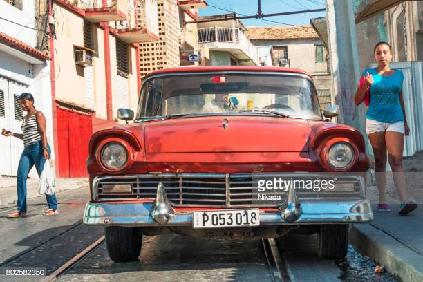 Old red vintage Car on the street, Cuba