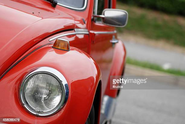 old red volkswagen beetle in the street - beetle stock pictures, royalty-free photos & images