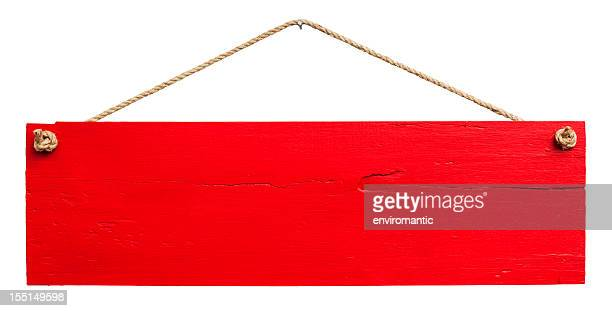 Old red weathered wood signboard.