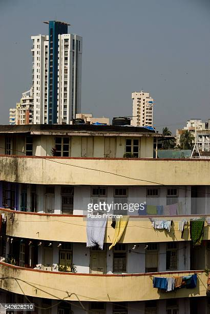 Old residential building and new construction in the background in Mumbai Maharastra India