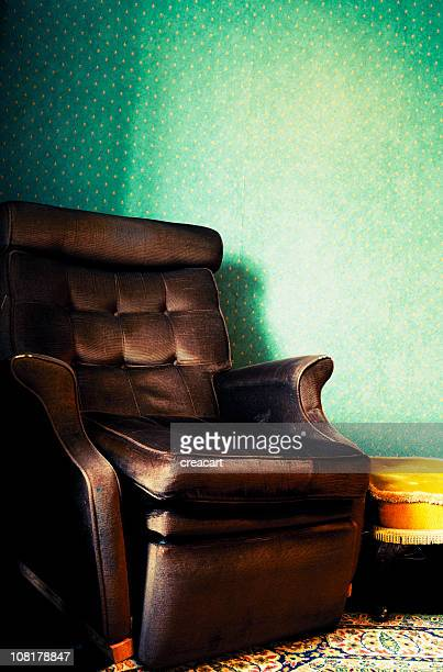 old retro armchair in vintage home interior - reclining chair stock photos and pictures