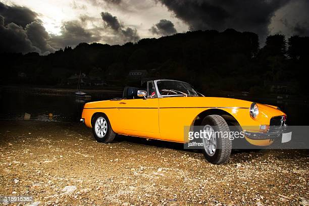 old retro yellow classic british sports car - 1970s muscle cars stock pictures, royalty-free photos & images