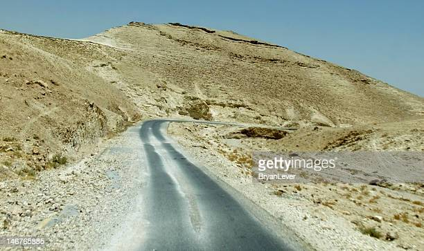 old road from jericho to jerusalem, israel - jericho stock photos and pictures