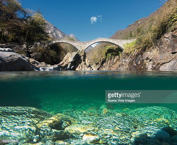 old roman bridge over clear waters - ticino canton stock pictures, royalty-free photos & images