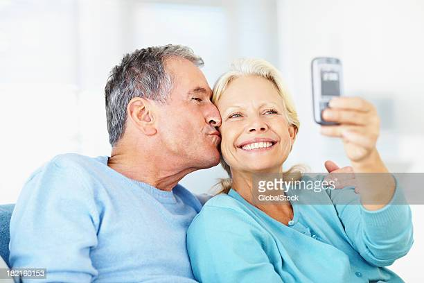 Old romantic couple self photographing